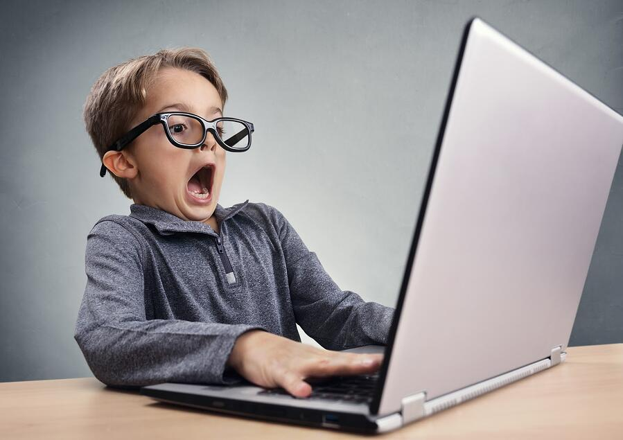 child on laptop scared by what he sees