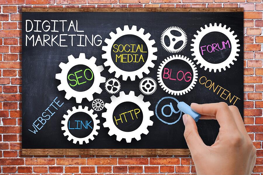 Chalk gears showing digital marketing elements
