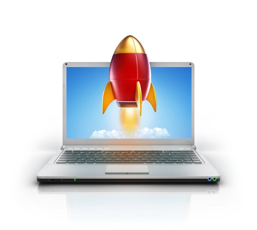 rocket blasting off of laptop screen