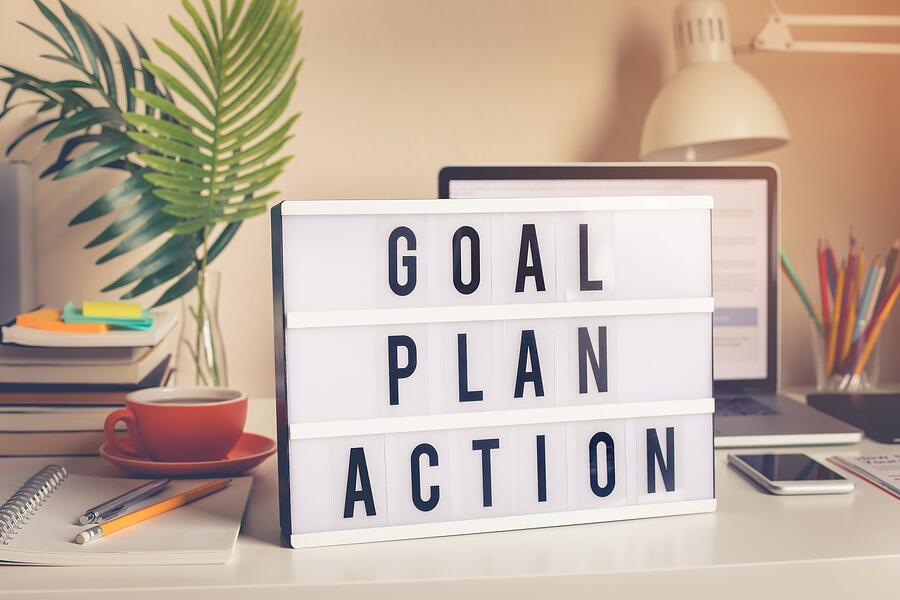letterboard with words Goal, Plan, Action