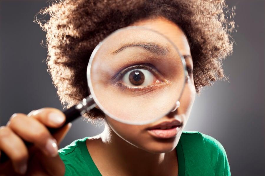 viewing financial advisor website through magnifier