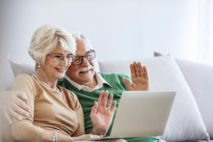 older couple having virtual meeting with financial advisor