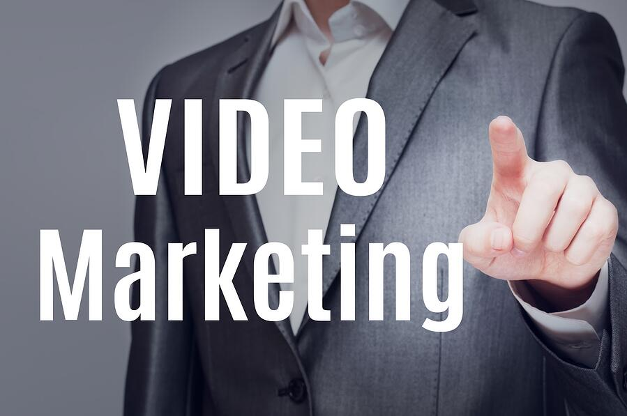 man in suit with words video marketing