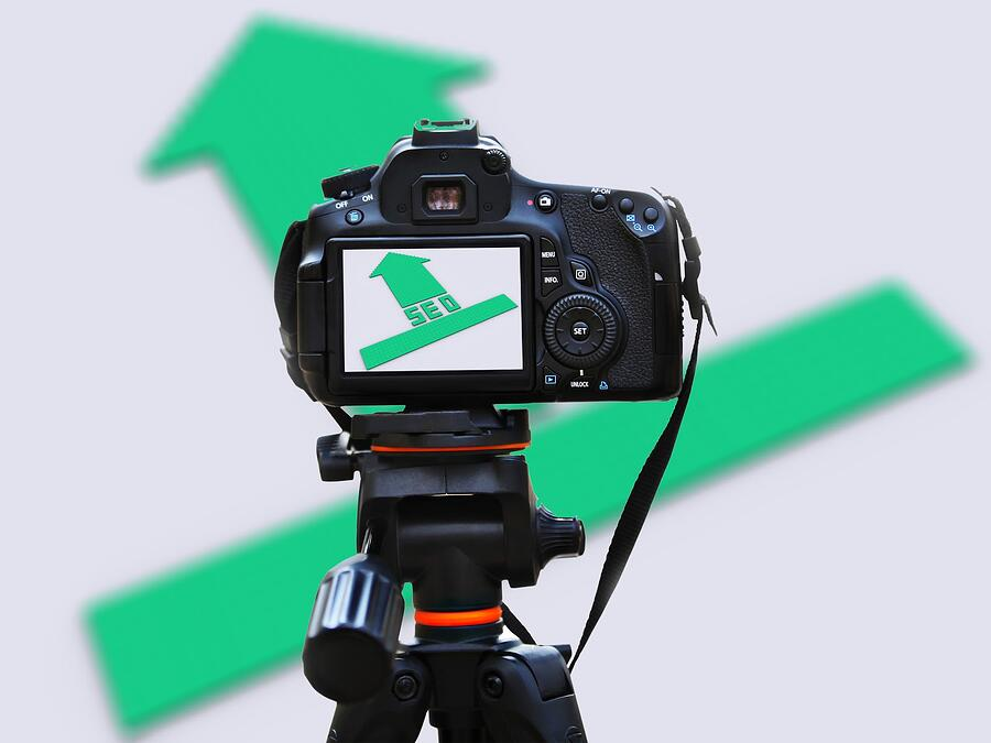 video camera taping a green arrow