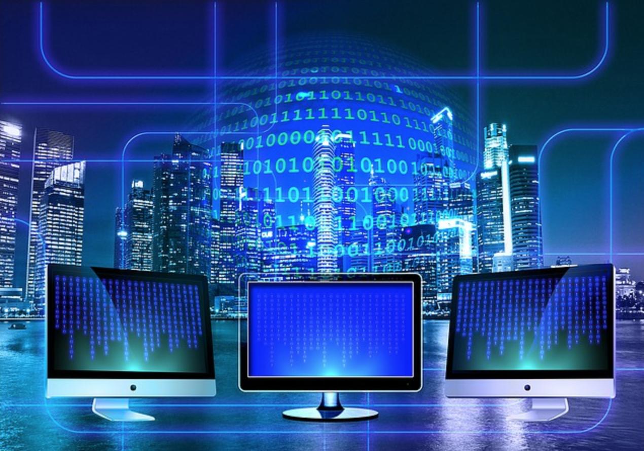 desktop computers with 1's and 0's floating around them representing virtual financial advisor marketing www.paladindigitalmarketing.com