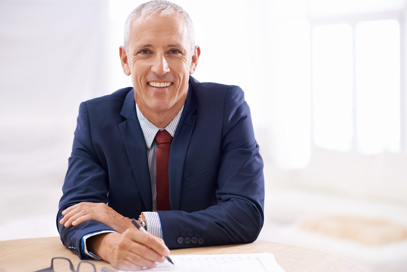 happy financial advisor at desk