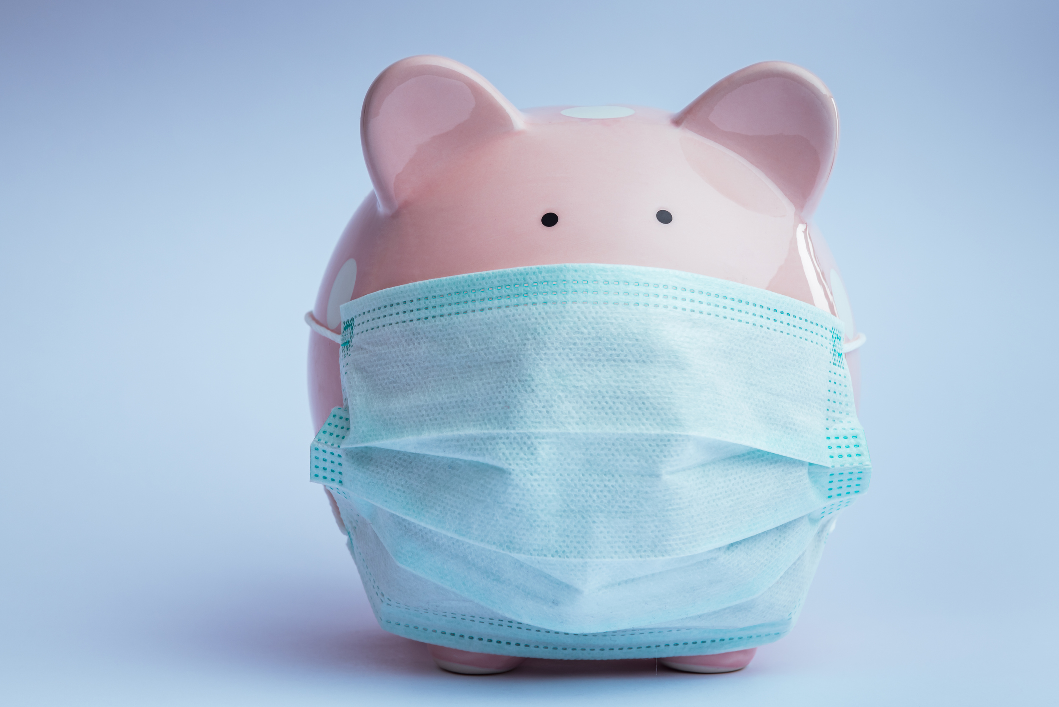piggy bank wearing a facemask representing the coronavirus pandemic and investor/advisor communications www.paladindigitalmarketing.com
