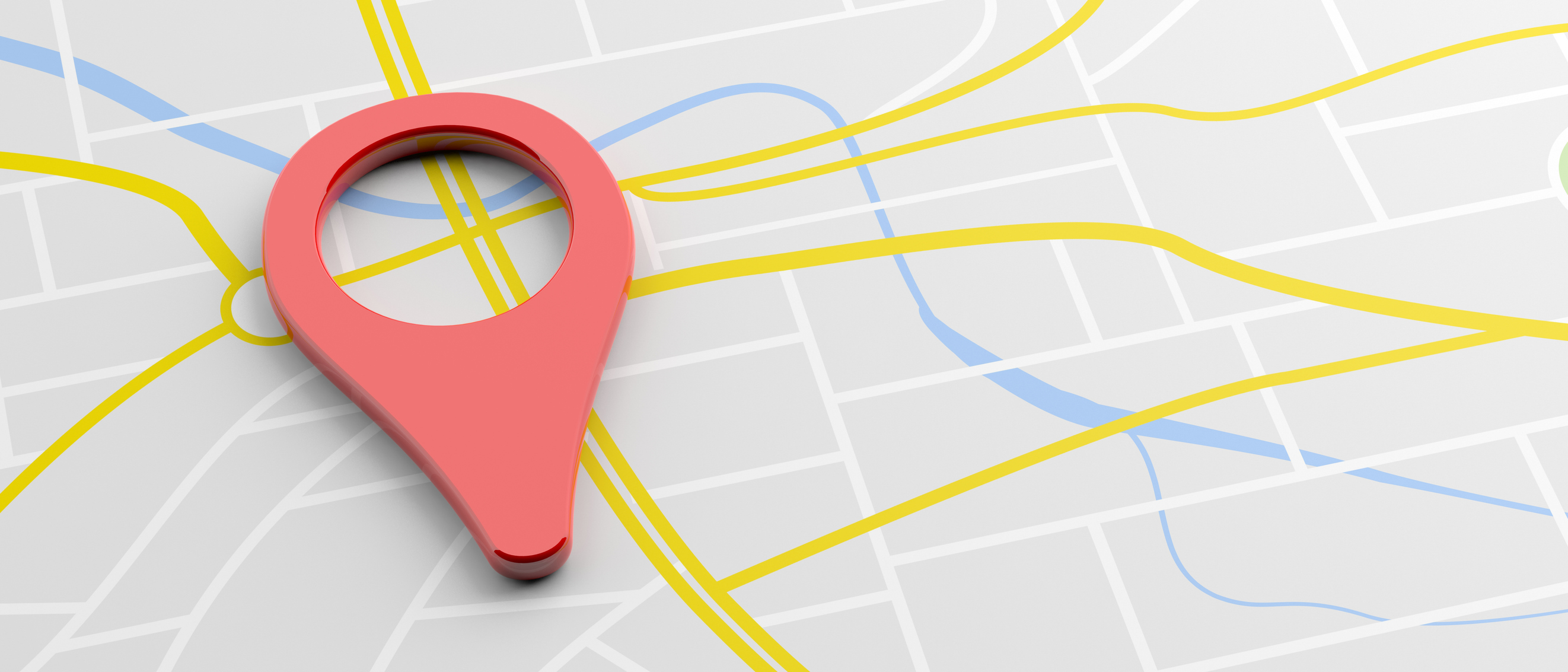 Image of a map with a magnifying glass on top, indicating a local search for a financial advisory firm