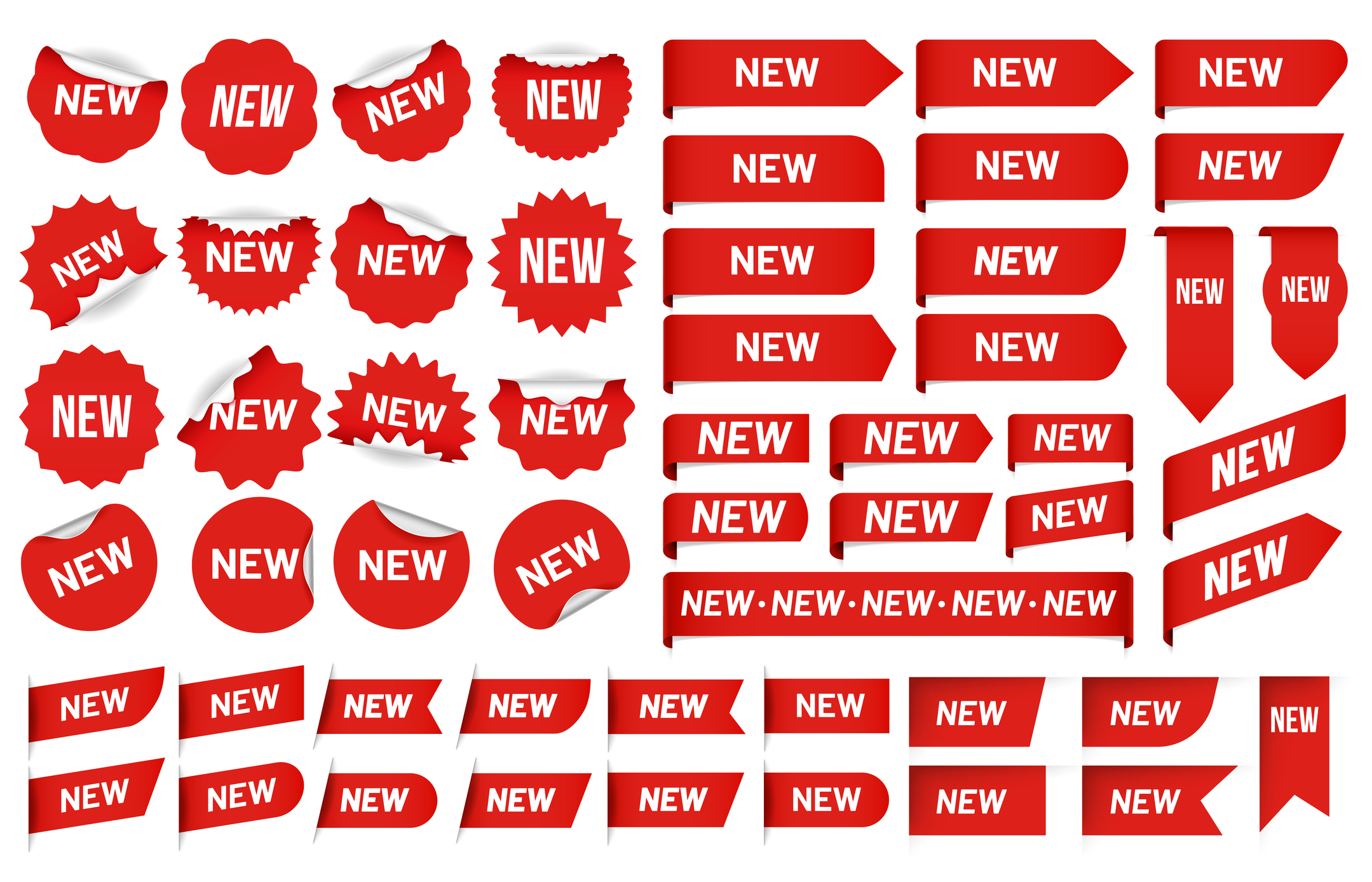 The word new on stickers, symbolizing a new website