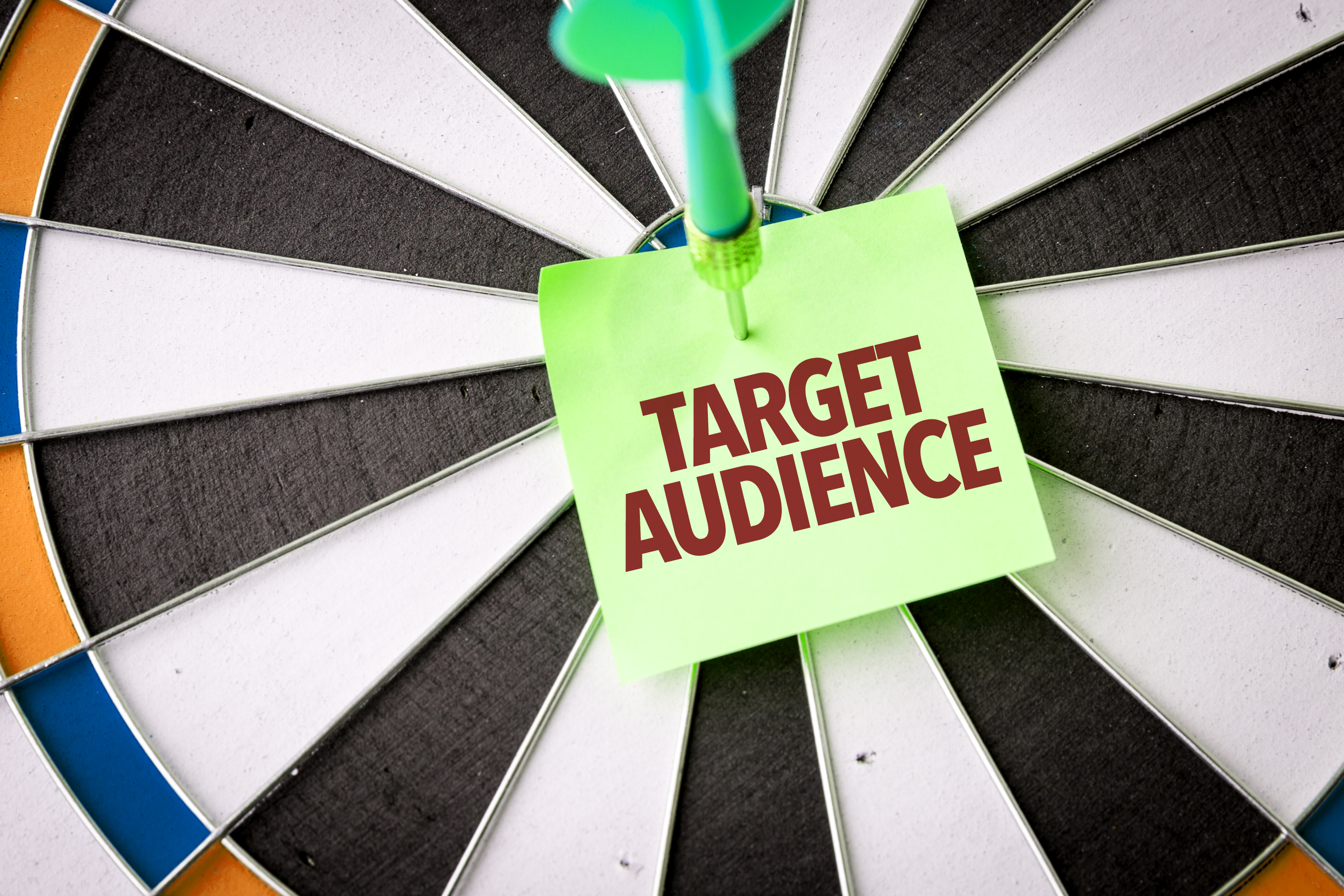 Bullseye dart board with target audience in the center.