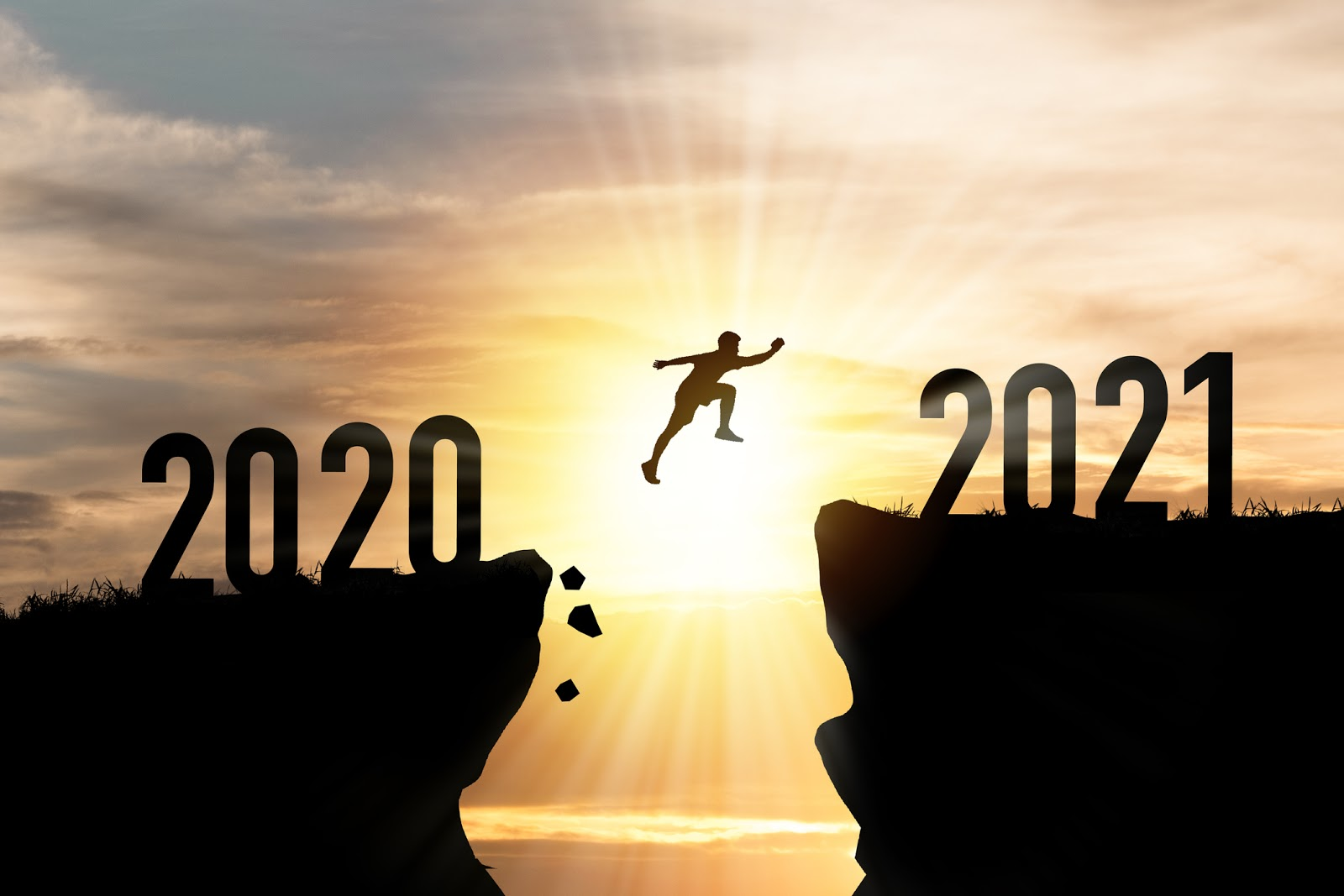 person leaping from 2020 to 2021