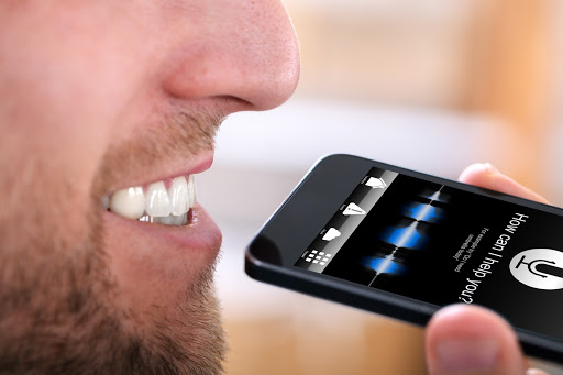 man using voice search on smartphone