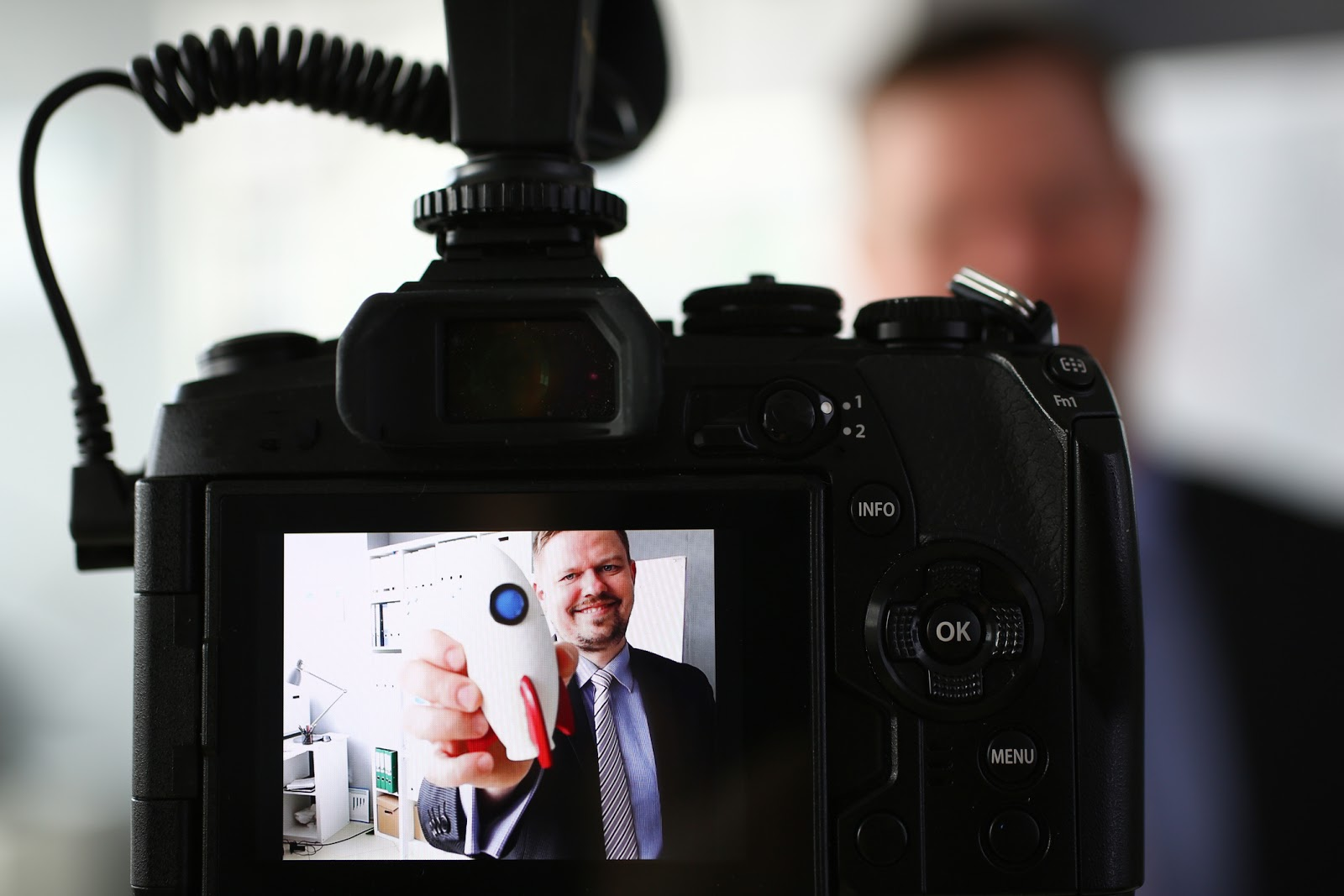 man on video camera with prop